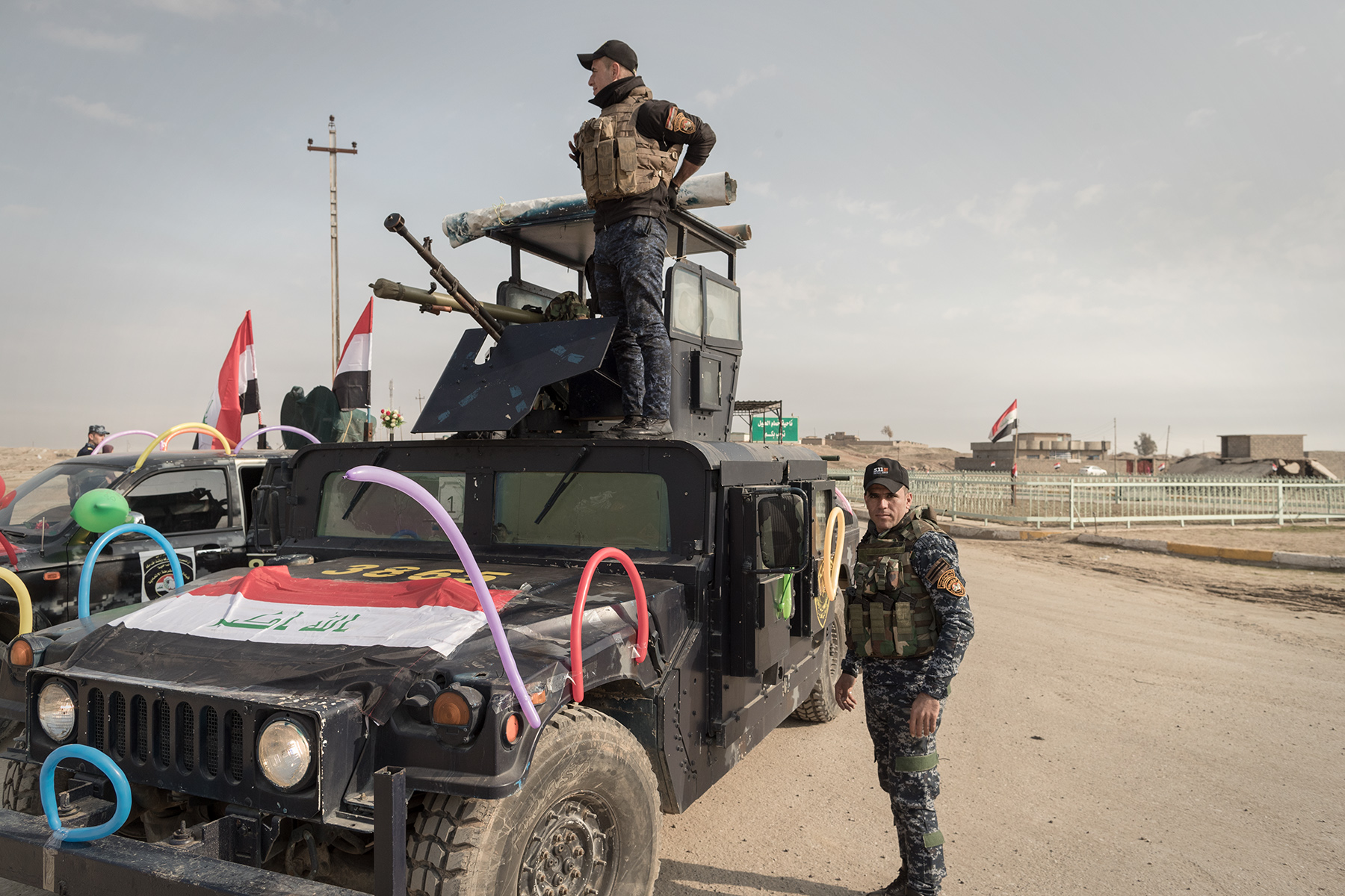 Military drive decorated humvees and distribute sweets during the Police Day in Hammam al-Alil, Iraq on Jan. 9, 2017. The predominantly Shiite Federal Police tries hard to cajole the Sunni civilians.
