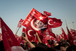 Erdogan supporters wave flags to celebrate for a last time the victory over the failed coup d'etat during a giant rally in  Istanbul, Turkey. Aug. 7, 2016.