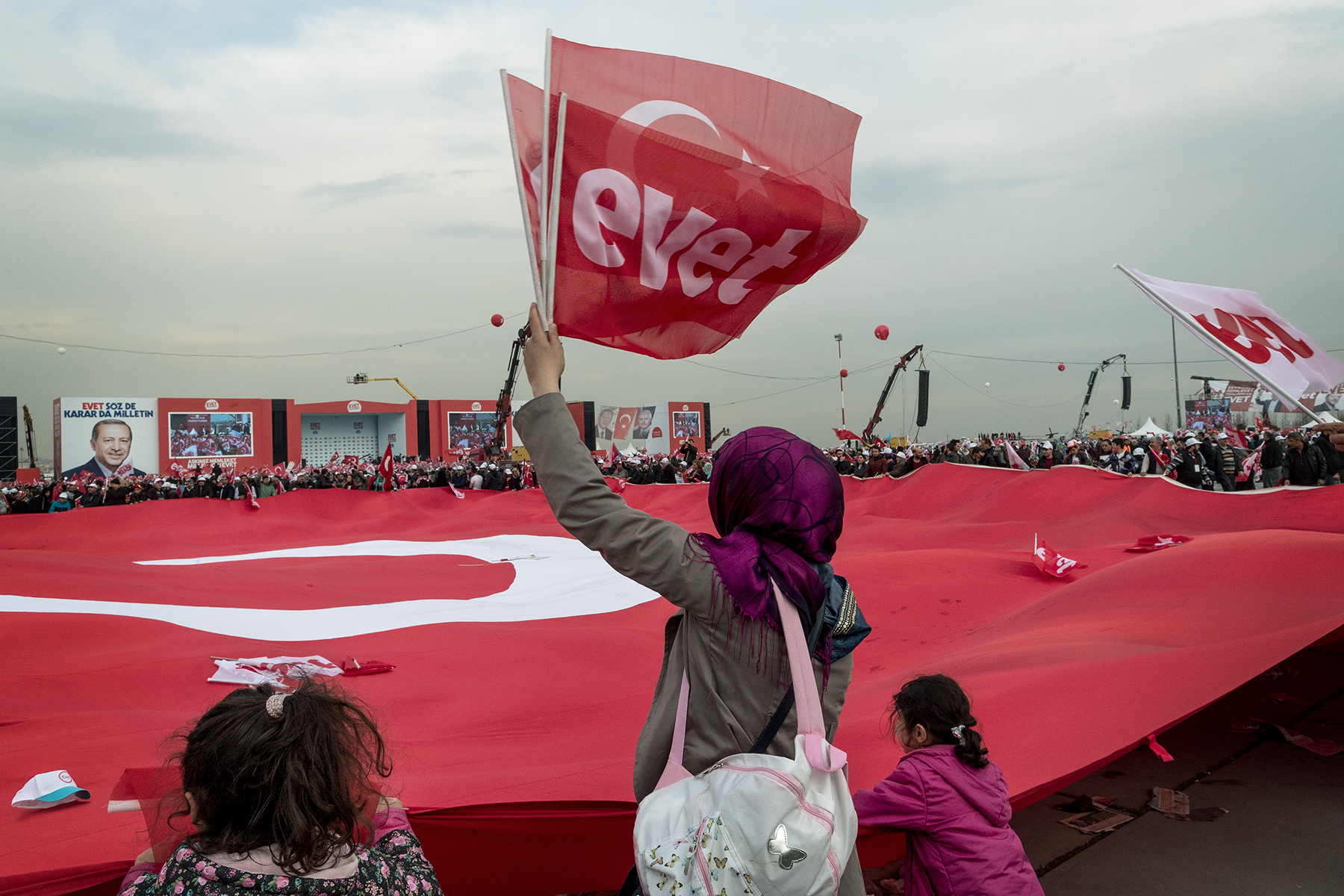 A woman waves a flag reading 'yes' (evet) during a campaign rally one week before the referendum vote at Yenikapi Square in Istanbul, Turkey on April 8, 2017.
