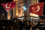 Supporters of President Recep Tayyip Erdogan celebrate in front of AKP headquarter after Prime Minister Binali Yildirim declared victory in referendum over presidential powers in Ankara, Turkey on April 16, 2017.