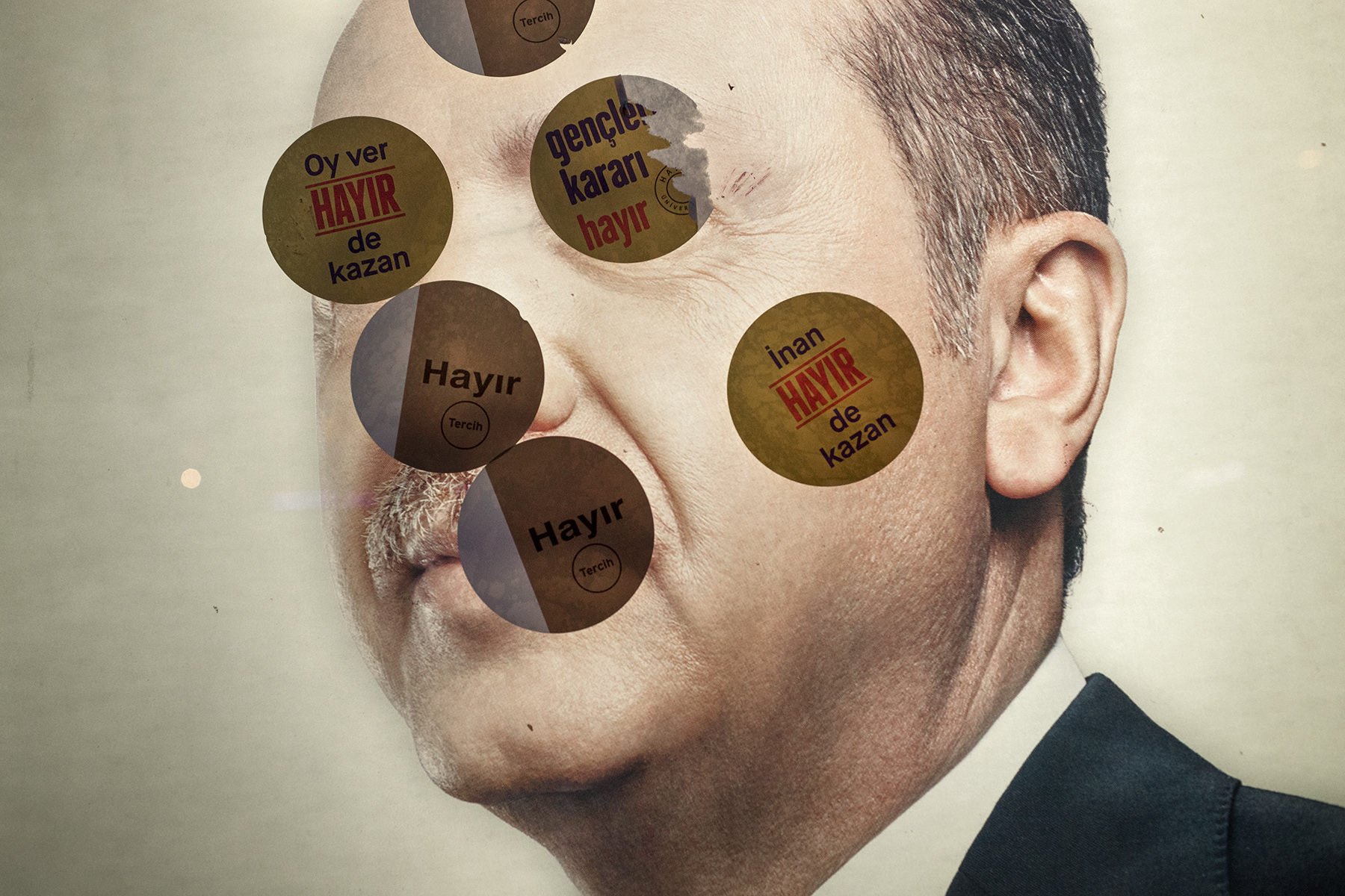 Stickers 'to believe in the victory of no' for the referendum are applied on a political poster with the effigy of President Recep Erdogan in Istanbul, Turkey on April 12, 2017.