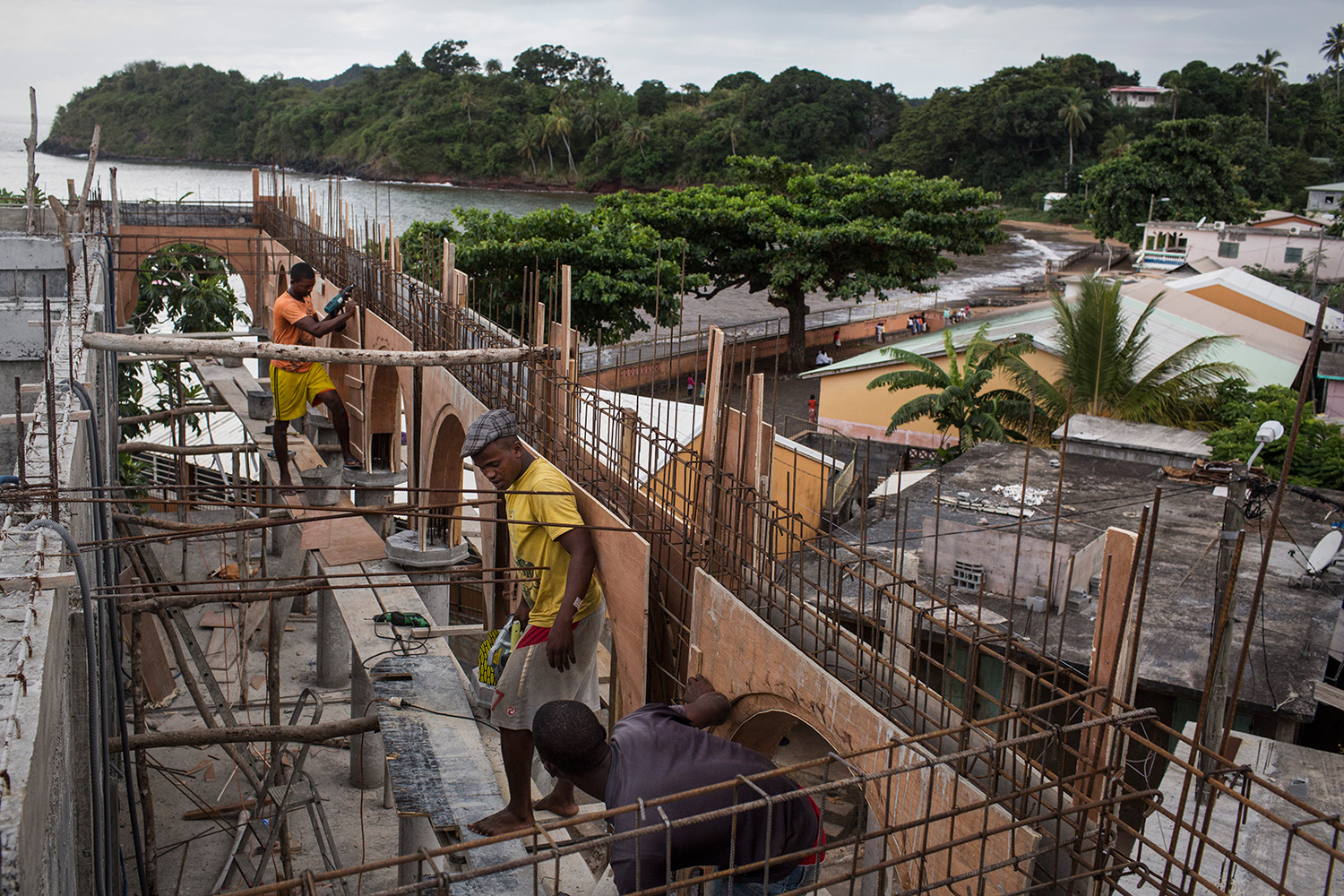 Workers enlarge the Mosque Vendredi in Mtsamboro at north of Mayotte on Monday, June 15, 2015. Most of the migrants disembark from kwassa on Mtsamboro islet, the nearest point to Anjouan. The illegal immigrant population of Mayotte may reach 50.000 to 60.000 people, approximately 30% of its legal population.