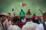 Men play a card game in the streets of Mutsamudu, Anjouan, Comoros on Wednesday, June 17, 2015.