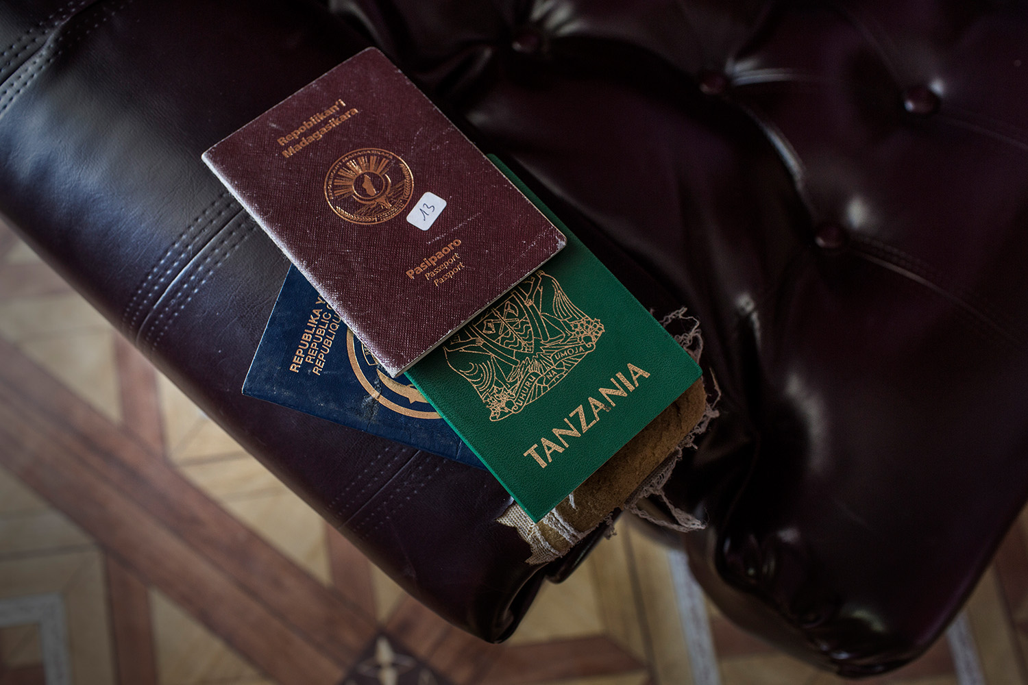 Some of the many passports of missing illegal migrants stored in the immigration offices of Mutsamudu, Anjouan, Comoros on Wednesday, June 17, 2015.