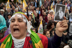 A supporter of the Peoples' Democratic Party (HDP) shouts slogans in Istanbul on May 4, 2018 and holds a picture of candidate Selahattin Demirtaş in jail for terrorism investigation.