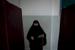 A woman leaves a polling booth with a ballot paper and a stamp during the elections day in Yalova on June 24, 2018