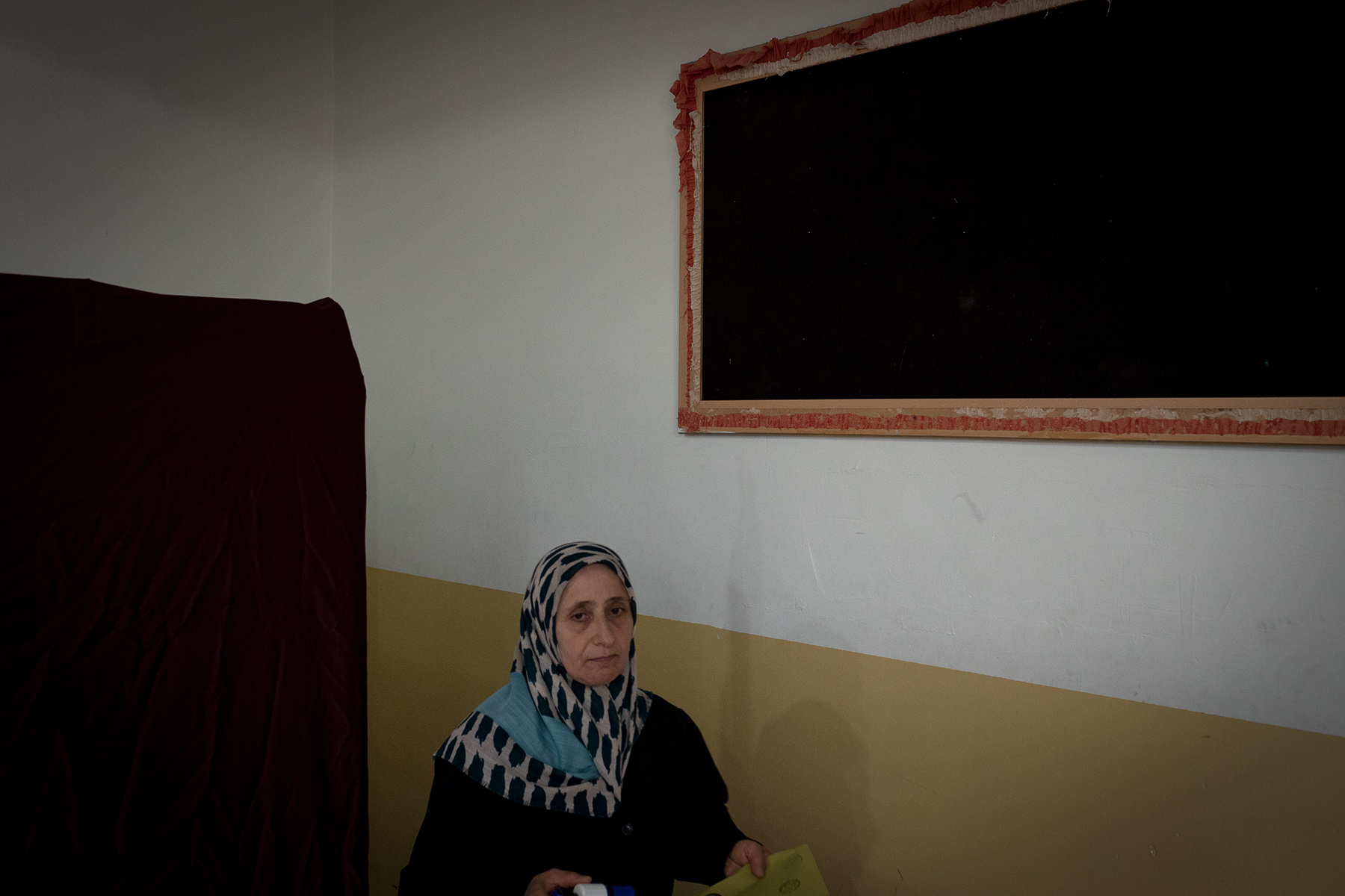 A woman leaves a polling booth in a school of Yalova during the elections day on June 24, 2018
