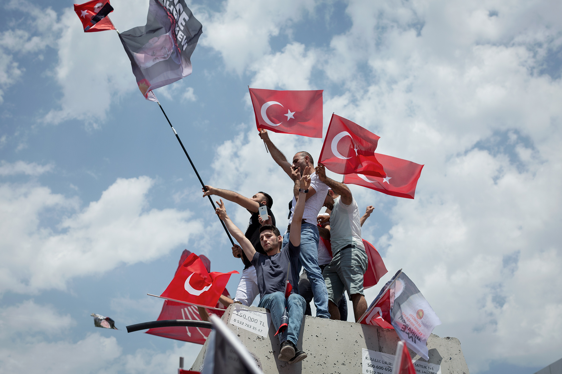 Supporters of the main opposition Republican People's Party (CHP) presidential runner Muharrem İnce wave flags during a small rally in Istanbul western suburbs on June 10, 2018