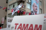 A placard reading '#TAMAM' _to request the departure of President Recep Tayyip Erdoğan_ is seen under a portrait of CHP president Kemal Kılıçdaroğlu during a rally in Istanbul western suburbs on June 10, 2018