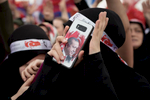 A supporter of President Recep Tayyip Erdoğan holds a smartphone with his face during a rally in Istanbul on June 17, 2018
