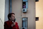 A man looks from his apartment window to candidate Meral Akşener (IYI Parti) during an electoral rally in Istanbul on June 21, 2018