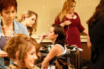 Hair and makeup artists get the contestants ready.