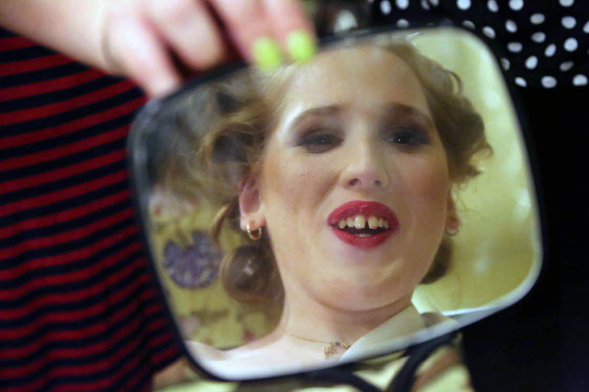 Elizabeth Schrack, Ms. Wheelchair Ohio 2014, reacts to seeing her hair and makeup, which has just been done.