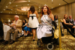 "Jennifer Adams, from Tacoma, WA, the reigning Ms. Wheelchair America 2014, watches the judging. Adams, who has a BA in psychology and a Master's in counseling, is a motivational speaker. She sees her disability as a gift, which ""actually forges something inside of you, a strength maybe other people don't have."""