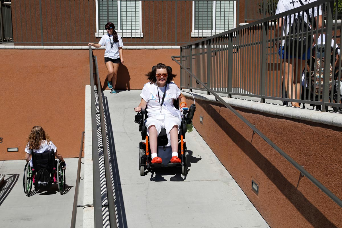 Michele Meadors, Ms. Wheelchair Iowa 2014, whips down a multi-level handicamp ramp on the way to an outing at the Long Beach Aquarium. Appointed by Iowa's governor to the State Independent Living Council, she works to address obstacles faced by disabled people who want to live independently in community settings.