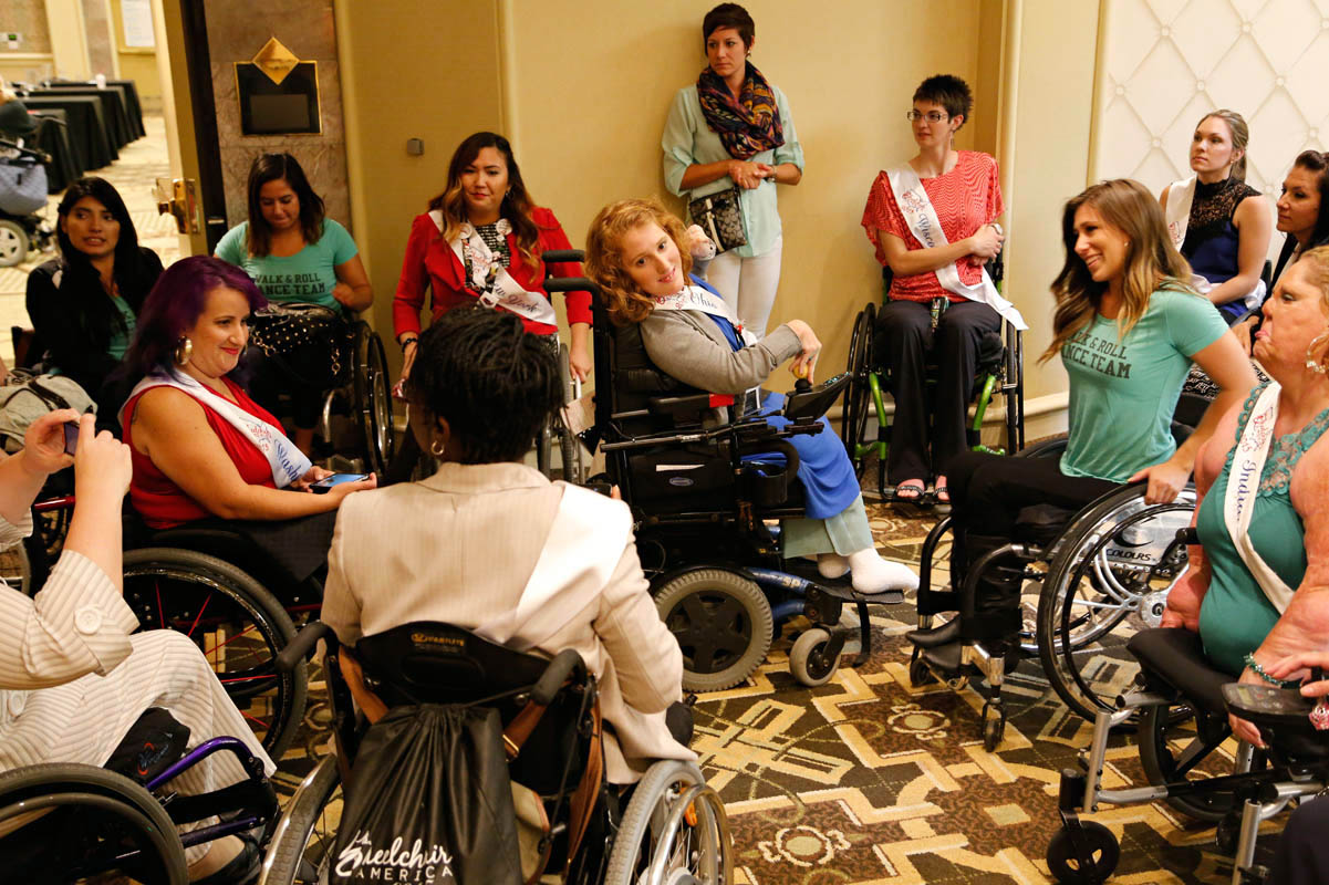 Pageant contestants chat with members of the Walk and Roll Dance Team, who came to give a workshop on wheelchair dancing.