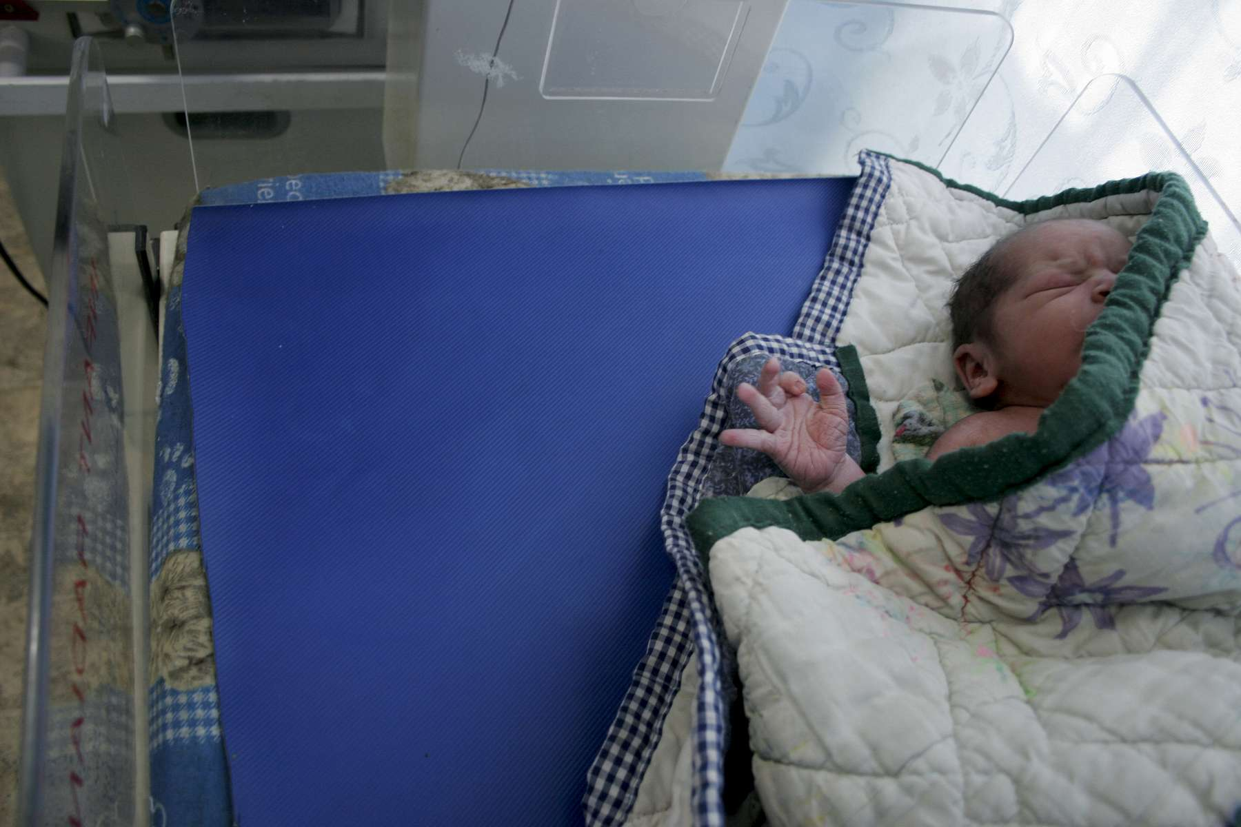 A newborn, delivered by caesarean section, in the hospital's nursery. One in four Afghan children do not live to the age of five. Lowering mortality rates for women and children is one of the top priorities of Afghan government officials and international aid workers.