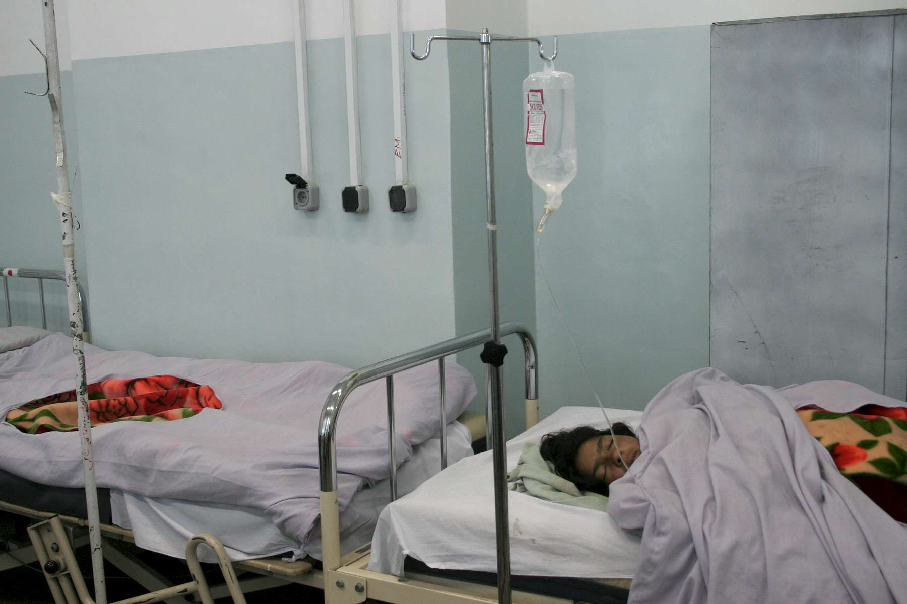 A woman rests in the post-op room, after a caesarean section delivery. Almost half of the deaths of Afghan women of reproductive age are due to pregnancy or childbrith compliations, according to a 2006 World Bank report. Of those deaths, an estimated 75 percent are preventable.