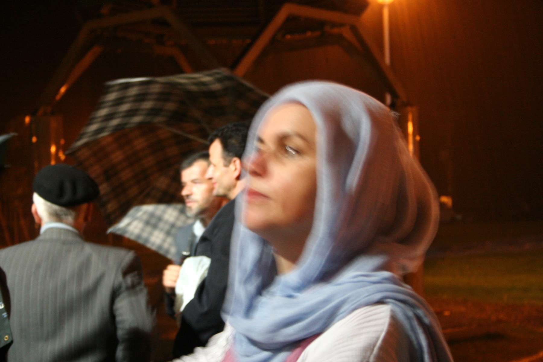 Men and women gather at the Srebrenica memorial site for prayers as rain pours on the eve of the commemoration ceremonies marking the tenth anniversary of the massacre of some 7,000 to 8,000 Muslim men and boys by Serb forces in July 1995.