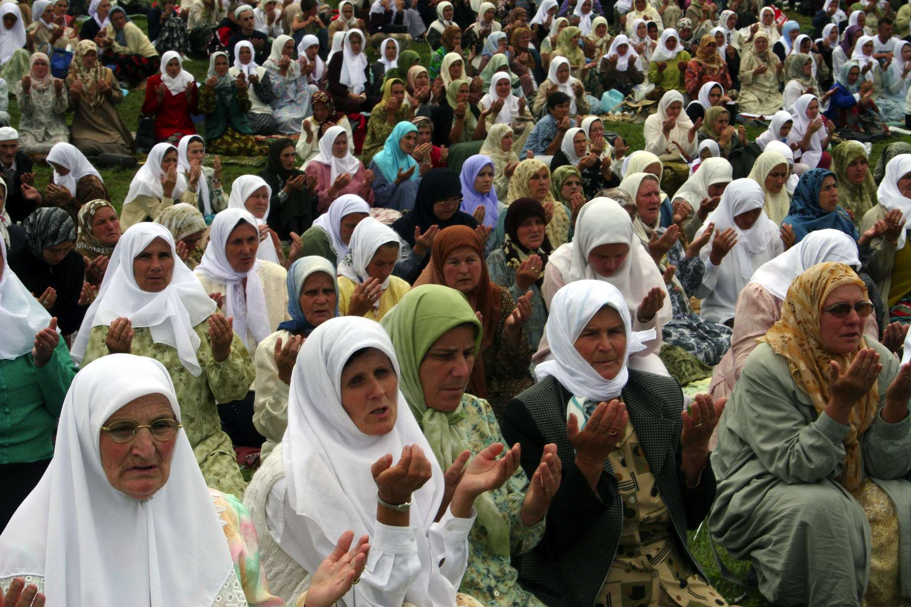 Muslim women in prayer on the day of the tenth anniversary of the Srebrenica massacre. Some 7,000 to 8,000 Muslim men and boys were killed by Serb forces in 1995, in the worst genocide in Europe since World War II.