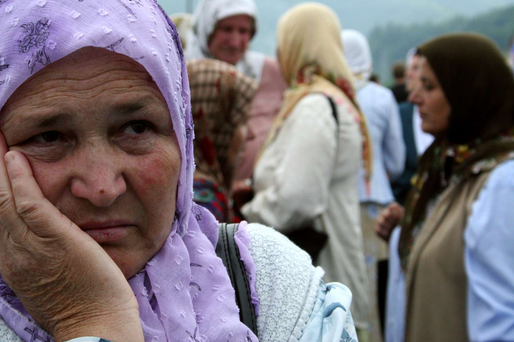 Muslim widows wait for the arrival of the remains of more than 600 men and boys killed at Srebrenica by Serb forces in 1995. The remains will be buried on July 11, as part of the commemoration ceremonies marking the tenth annivesary of the worst genocide in Europe since World War II. More than 1300 remains have already been buried at the site, in the village of Potocari near Srebrenica. Thousands of other remains have yet to be exhumed from mass graves and identified.