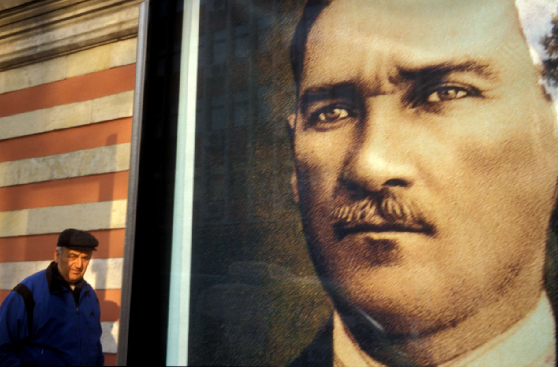 A pedestrian passes by one of the many portraits of Mustafa Kemal Ataturk which can be found all over Turkey, from offices and schools, to theatres and museums. Although he died in 1938, Turks still revere the man who led them in their war of independence from 1920 to 1922 and became the founder of the Turkish Republic in 1923. Turkish nationalism -- along with its growing Islamic conservatism -- concern many Europeans who worry that such attitudes will be at odds with the European Union\'s efforts to create a united body of nations. In Decmeber, 2004, the EU agreed that accession talks for Turkey\'s entry into the union will begin in October 2005 and could last as long as a decade.