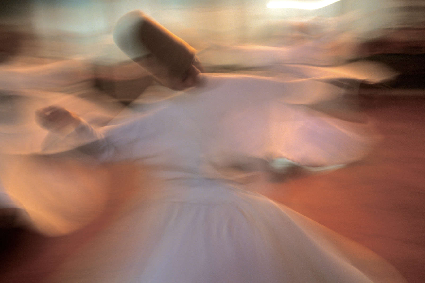 A dervish whirls during a sema, or prayer ceremony. June 2005.