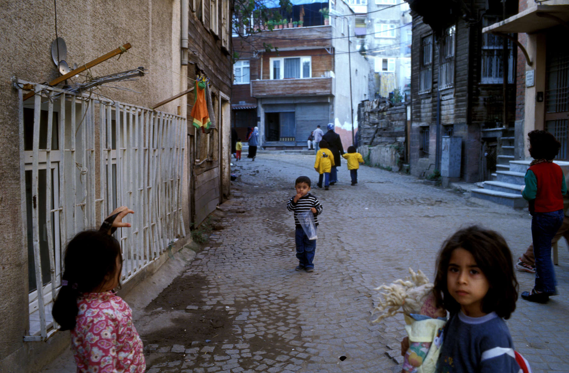 Children play in the streets of Zeyrek, a religiously conservative working-class neighborhood of Istanbul. Among the concerns voiced by Europeans who oppose allowing Turkey to join the European Union is the fact that Turkey\'s population of nearly 70 million -- which is almost entirely Muslim -- is growing at a rapid 2.3 percent per year. In December 2004, the EU agreed to begin accession talks with Turkey in October 2005. Turkey\'s membership in the EU would create more mosque-going Muslims in Europe than church-attending Protestants.