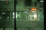Waiting for a tram to come at one of the stops on Istanbul\'s Divan Yolu street. November 2004