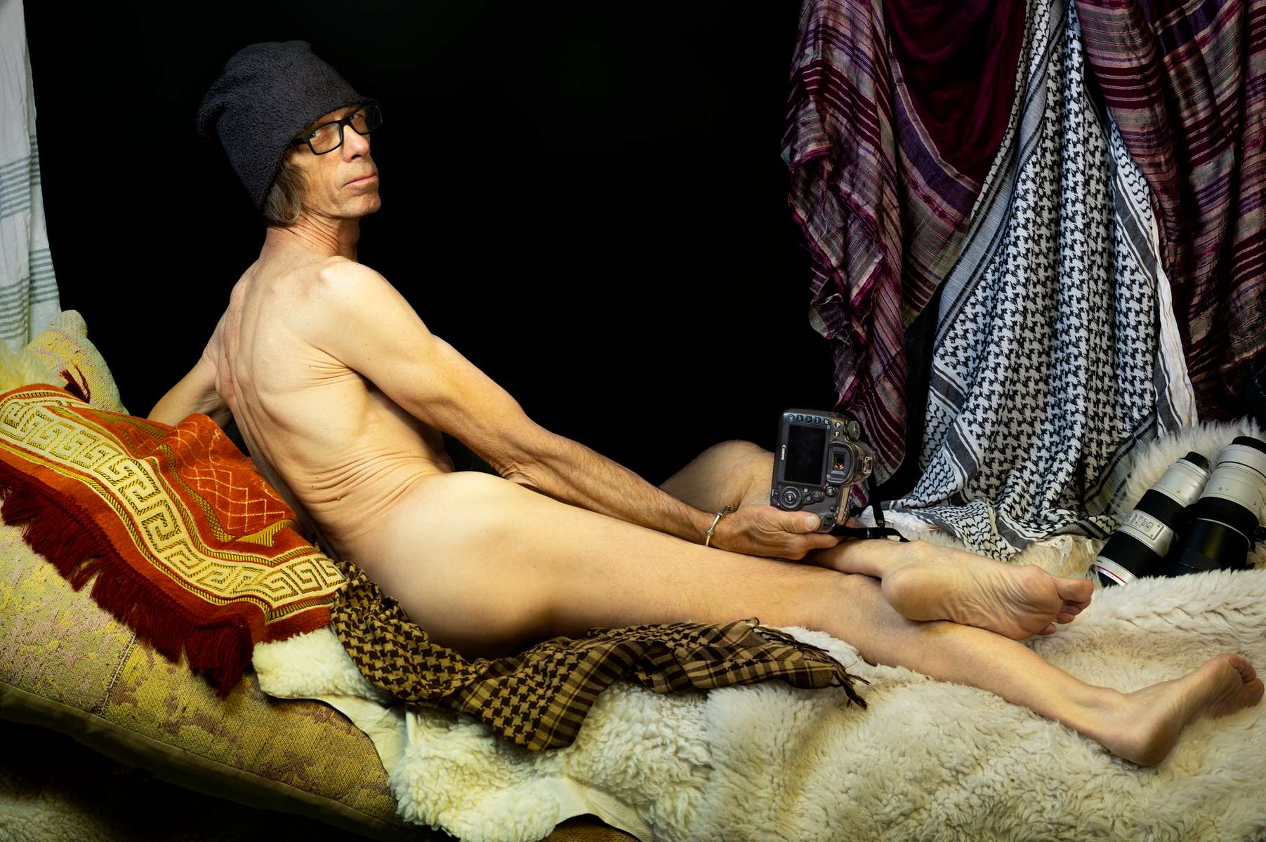 """From my earliest thoughts about Ingre's Grand Odalisque, I knew that I needed a white male photojournalist for this photo; I knew that I wanted to comment on the othering perpetuated by the white male gaze of my industry for decades. This was my response to learning that Ingres' Odalisque, painted in 1814, was used to justify French colonialism -- an othering of peoples in the Near East and North Africa as a way of {quote}proving{quote} that they desperately needed France's {quote}civilizing{quote} authority. It's something that photojournalism, unfortunately, has done for a long, long time – justified a white, male Western point of view which has """"othered"""" women and people and cultures of color.In May 2019, in Sarajveo, at the annual general meeting of my photo agency, VII Photo, I asked my colleague Christopher Morris to pose for me, and he agreed, with some trepidation. Chris was a natural choice for me. There are connections between us. He covered the war in Bosnia; I covered the aftermath. The photo I made was also my invitation to him, to engage in a dialogue between artists about nudity and representation and who does the gazing.And we were in Bosnia, which was an important part of the Ottoman Empire – the very era which also prompted Ingres' painting and """"othering"""" of cultures France sought to bring under its subjugation. This was the place to make the photo, and Chris was the perfect model.I'm weary as I write this. It's the summer of 2019 and it's America, and the president of the United States (I will not use his name in the same sentence as the word """"president"""") others some one or some group of people with almost every tweet he makes, almost every time he opens his mouth. White, male, western power – and the power of naming.But we're fighting back, and women are leading the way. Power is shifting, slowly but surely, and I believe images can help move that story forward. I am weary, as I said, but I am hopeful."""