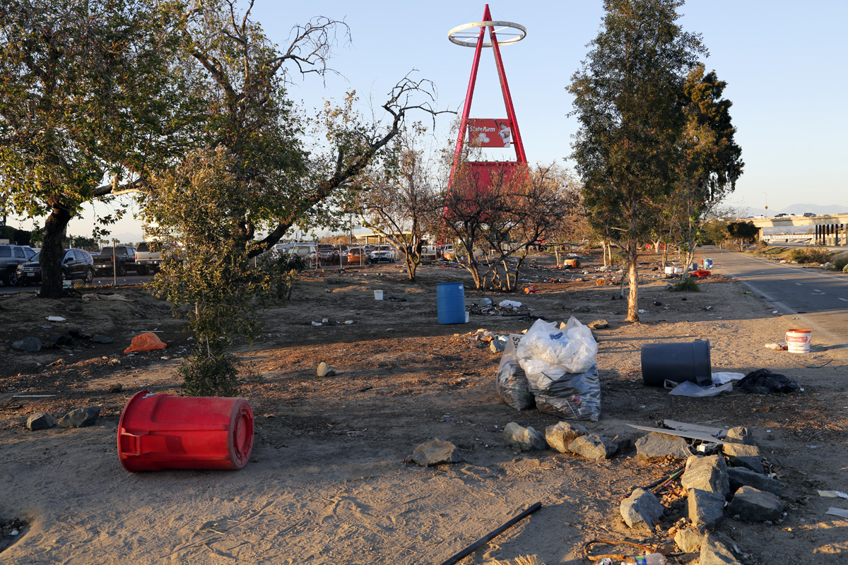 Within days of the camp's official closure on February 20, 2018, county clean-up crews moved through the encampment, tearing down structures that remained and cleaning up trash. On this particular night, Anaheim Stadium's adjacent parking lot was packed for a Monster Truck rally.