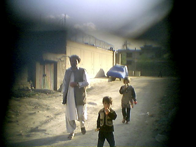 A father and his children in a Kabul neighborhood.