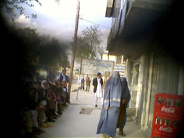 Burka-clad women walk down a Kabul street. Virtually all women in Kabul cover themselves in public -- most with a burka, others with long headscarves.