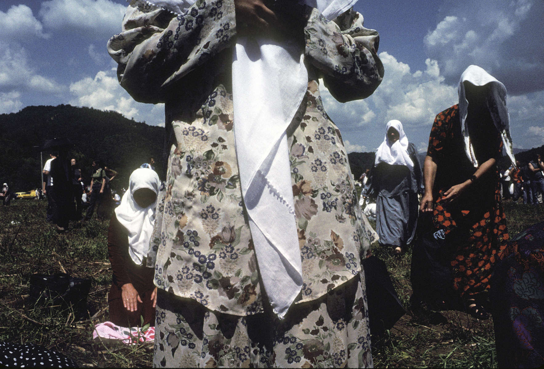 Muslim widows in prayer during dedication ceremonies for a planned memorial (which was completed in 2003) to the 7,000 to 8,000 Muslim men and boys who were killed by Serb forces in July 1995. The site is across the road from a now-abandoned factory where many of the victims were killed in the village of Potocari, just a few kilometers down the road from Srebrenica.
