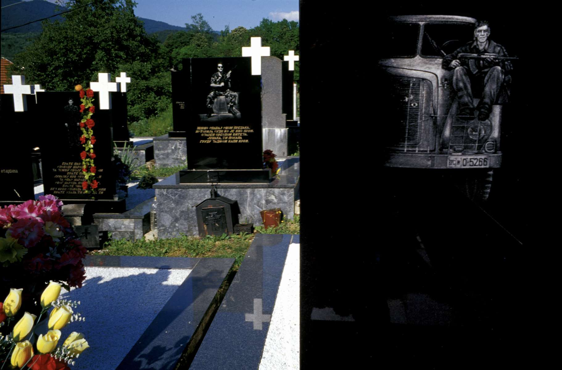 Laser-engraved headstones of Bosnian Serb soldiers who were killed during the war. The cemetery is in Visegrad, in eastern Bosnia, a town where some 2,000 Muslim men and boys were killed by Serbs in the spring of 1992. Eight years after the end of the war, the former Muslim-majority town remains overwhelmingly Serb.