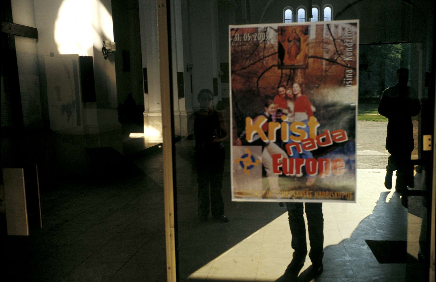 A poster on an entrance to the Catholic church in Bugojno reads, \{quote}Christ, savior of Europe.\{quote}