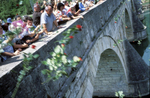 Hundreds of Muslims gather on the old Ottoman bridge on the river Drina in Visegrad to commemorate the approximately 2,000 men and boys who were killed during the beginning of the war by local Serbs. Visegrad has remained a notoriously nationalistic Serb town since the end of the war, a climate that has made it difficult for many Muslims to return to their homes. The situation in Visegrad was so tense that it wasn\'t until 2002, seven years after the end of the war, that Muslims were allowed to visit and hold their first commemoration cermony. This was the second such event.