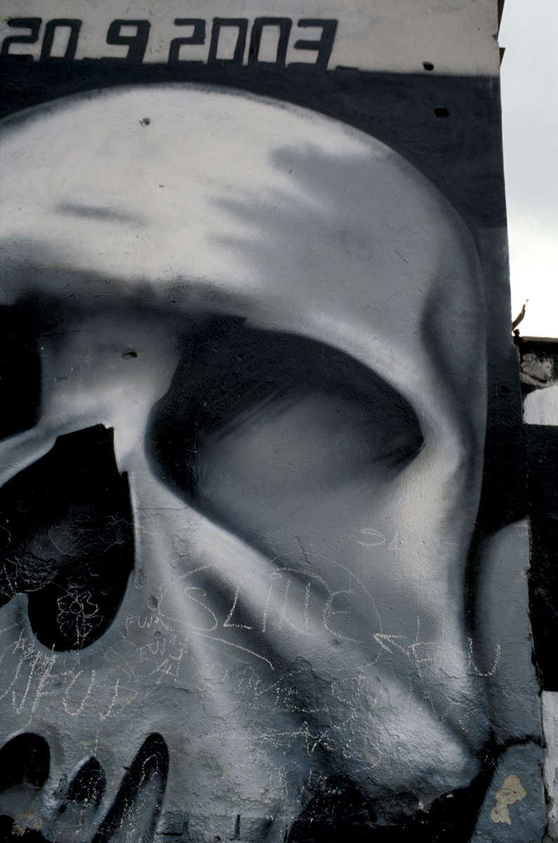A detail of a skull, which is part of a huge wall mural in Sarajevo, with the words \{quote}Never Forget,\{quote} a grim reminder of the Srebrenica massacre. May 2003.