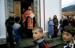 A Serb Orthodox priest holds an icon being auctioned to parishioners, who pay to carry the icons in a small procession that circles the church three times on Orthodox Easter Sunday. The church was damaged by extremist mujahideen who came to fight in Bosnia during the war, but was restored in recent years.