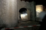 A policeman guards the entrance to the newly rebuilt Mostar Bridge the night before dedication ceremonies and the re-opening of the bridge, which was destroyed by Croat forces during the war.