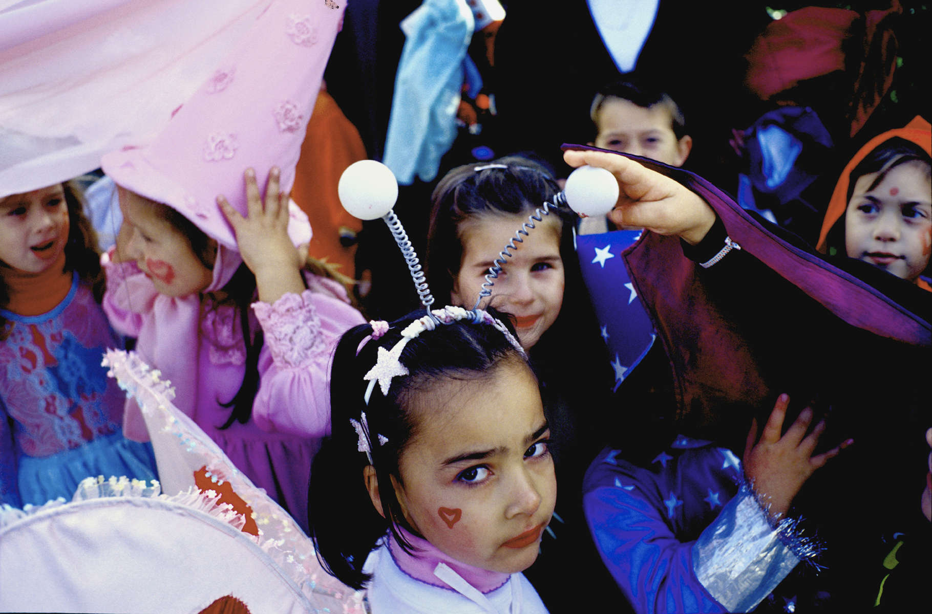Schoolchildren on a special dress-up day walk through the town of Prijedor.