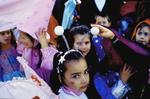 Schoolchildren on a special dress-up day walk through the town of Prijedor.