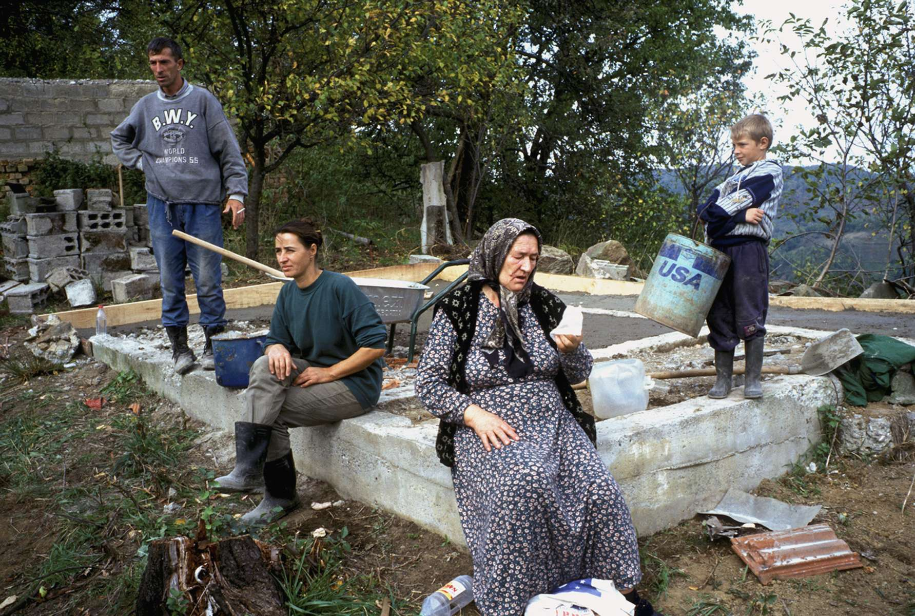 In the hills above Srebrenica, a Muslim family returns to rebuild a house destroyed during the war. By the year 2000, when record numbers of Bosnians finally felt safe enough to begin returning home, the international community began to suffer \{quote}Bosnia fatigue,\{quote} withdrawing resources and moving to other parts of the world. The result was that only 22 percent of those wanting to return home in 2000 received aid to do so, despite the fact that the right to return home was one of the founding principles of the Dayton Peace accords, which ended the war in late 1995. October 2000.