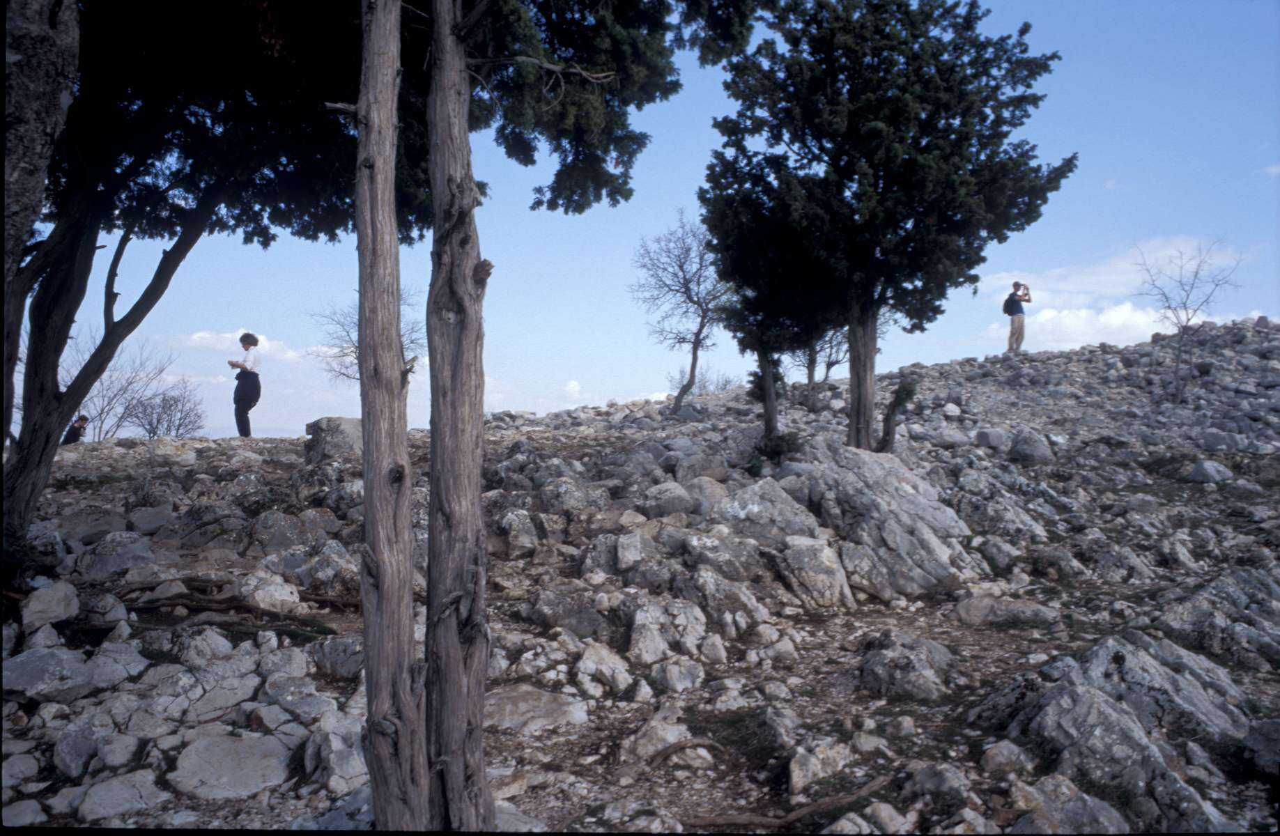Tourists on top of one of the steep, rocky mountains that ring the town of Medjugorje. The town has become a destination for thousands of Catholic pilgrims from around the world, ever since six teenagers claim to have received a message from the Virgin Mary in a vision in 1981.