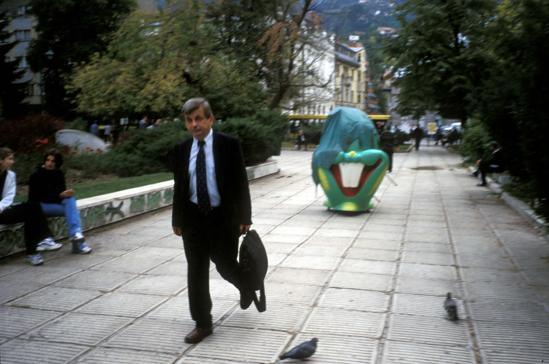 Street scene in the center of Sarajevo. The partially covered rabbit head is a popcorn machine being wheeled to a nearby street corner. April 2002.
