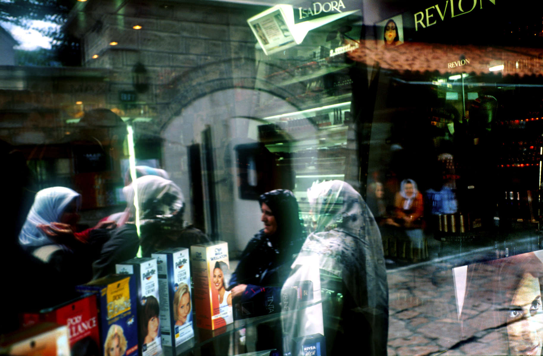 Window reflection, beauty store. April 2002.