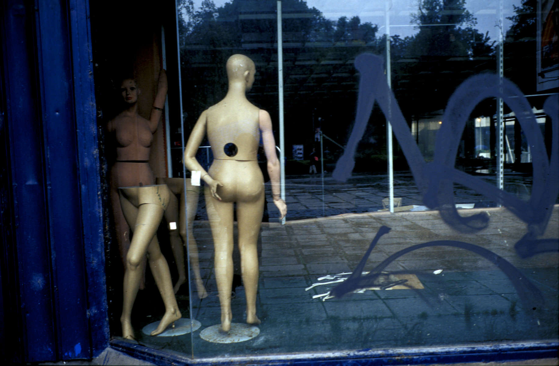 Mannequins in the window of what was the largest department store in Sarajevo before the war. Despite many plans to restore and re-open the building, it remains unused. April 2002.