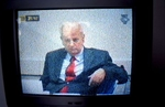 Televised proceedings of the trial of Slobodan Milosevic, the former president of Serbia, who was handed over to the International Criminal Tribunal for the Former Yugoslavia and sent to the Hague in 2000. Milosevic was indicted in November 2001 for genocide in Bosnia during the war; by early 2005, his trial was still ongoing.