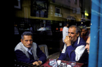 Men smoke cigarettes and drink coffee at one of Sarajevo\'s many coffeehouses. Drinking coffee is a local pasttime, but also a reflection of Bosnia\'s high unemployment rate, which hovers near fifty percent. April 2002.