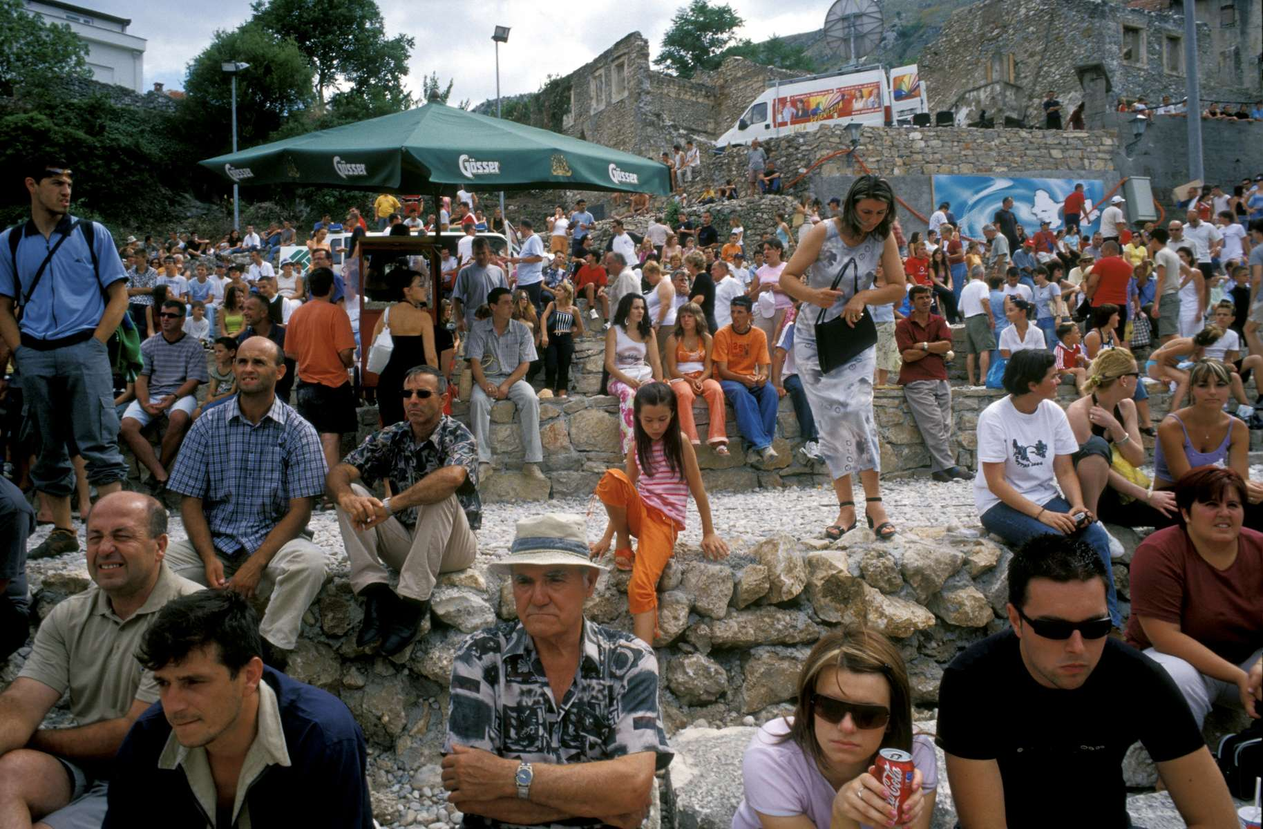 Crowds line the banks of the Neretva River, waiting for what locals say is the 448th annual jumping and diving competition. Local youth have proved their athletic prowess on the more than eighty-foot-high bridge for centuries. Even during the 1992-95 war, when the original bridge was destroyed, they continued to jump from the side of where the old bridge once stood.